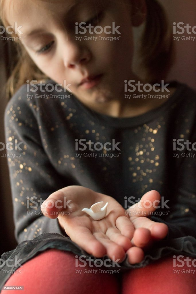 Child and dove wishing for peace stock photo