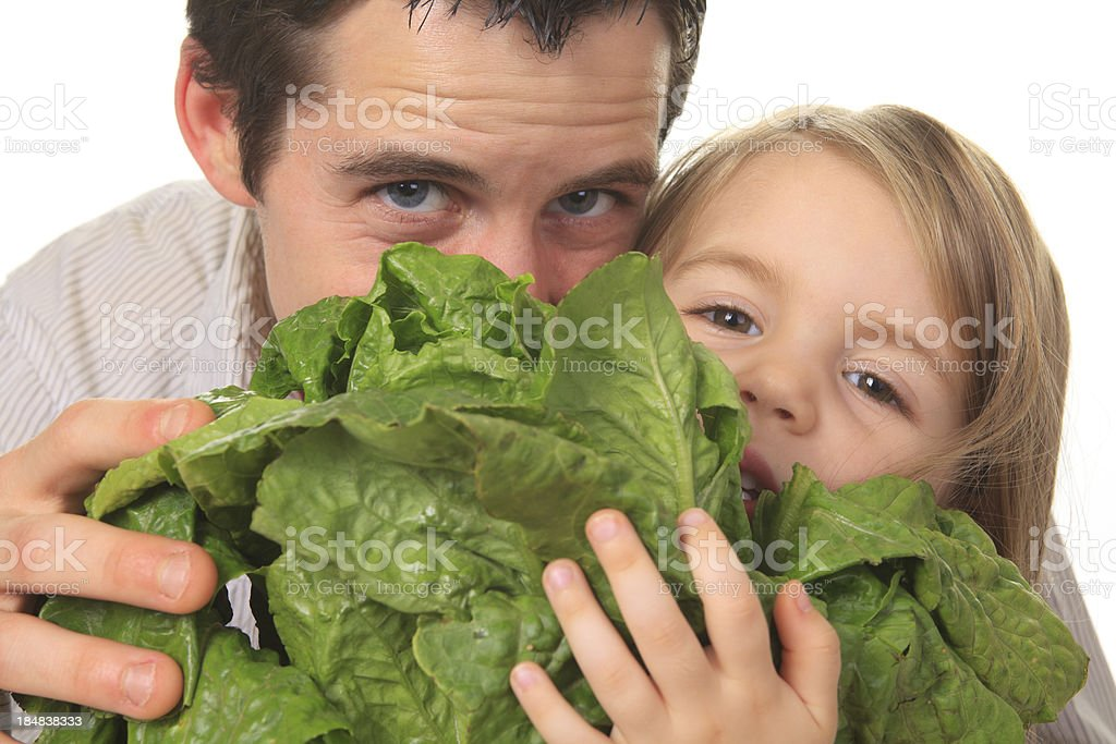 Child and Father Green Salad royalty-free stock photo