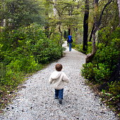 Child and Father in National Parkland, New Zealand