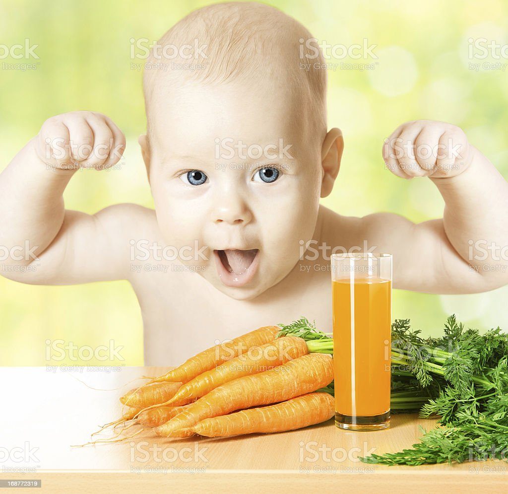 Child and fresh carrot juice glass royalty-free stock photo