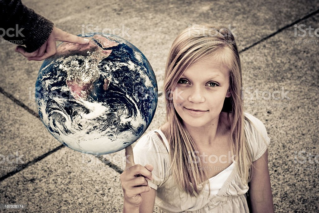 Child and globe representing a new generation royalty-free stock photo