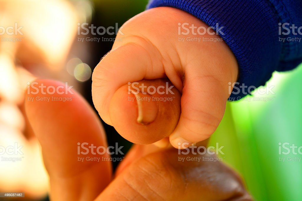 child and grandmother, holding the hand stock photo