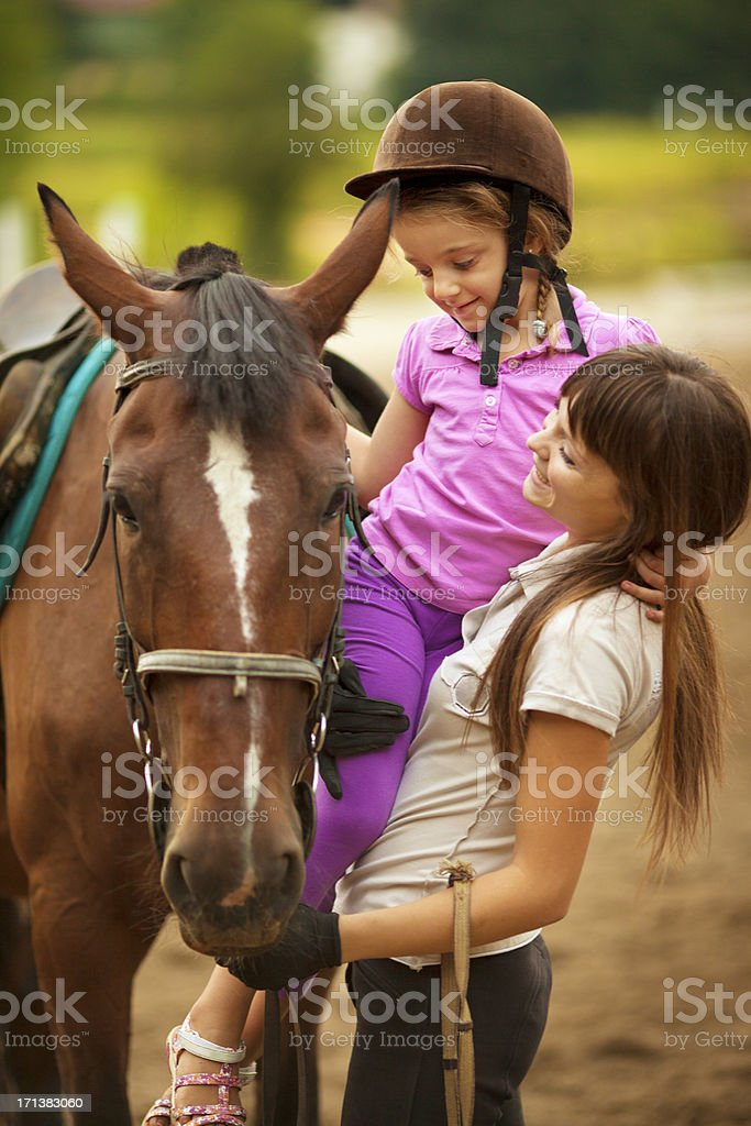Child and horse outdoors. stock photo