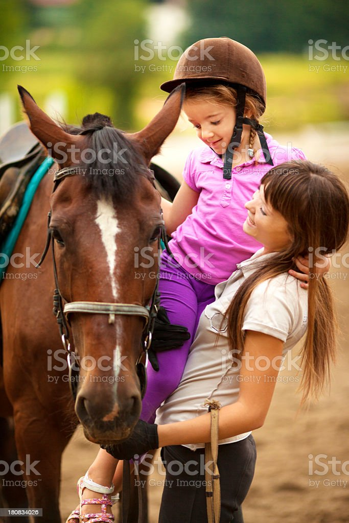 Child and horse outdoors. royalty-free stock photo