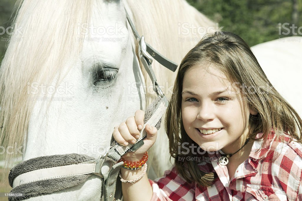 Child and horse royalty-free stock photo