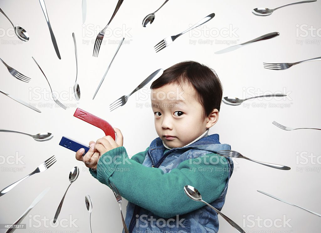 child and Magnet stock photo