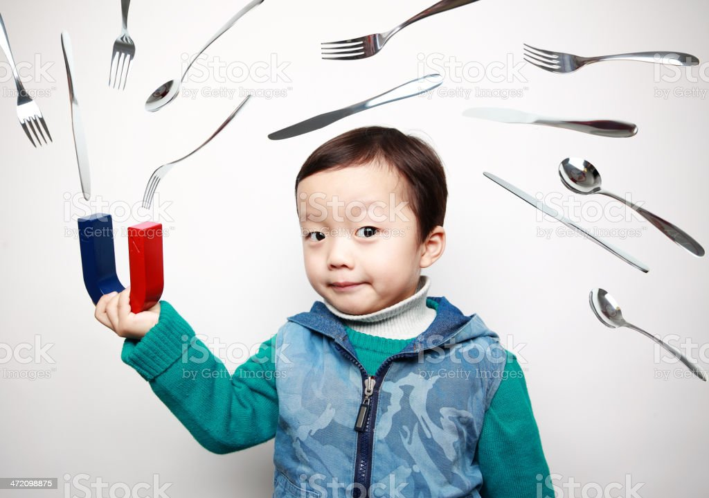 child and Magnet royalty-free stock photo