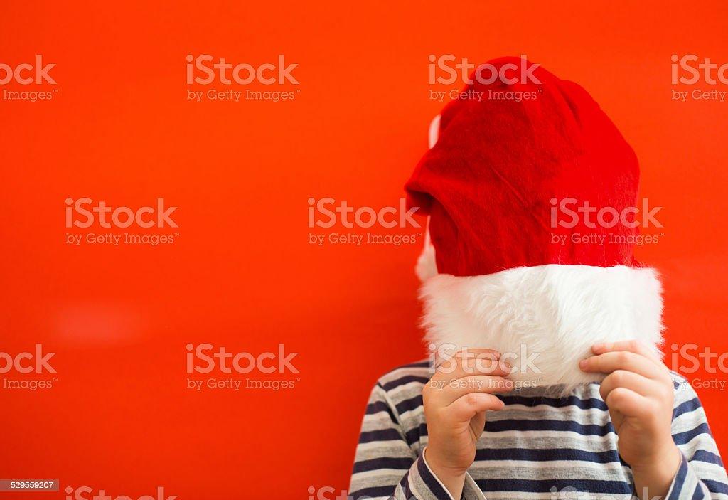 Child and Santa Hat stock photo