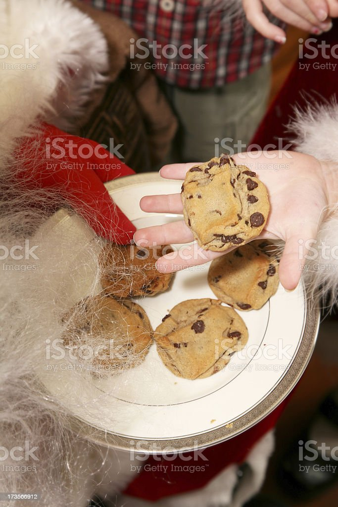 Child And Santa Sharing Cookies Together royalty-free stock photo
