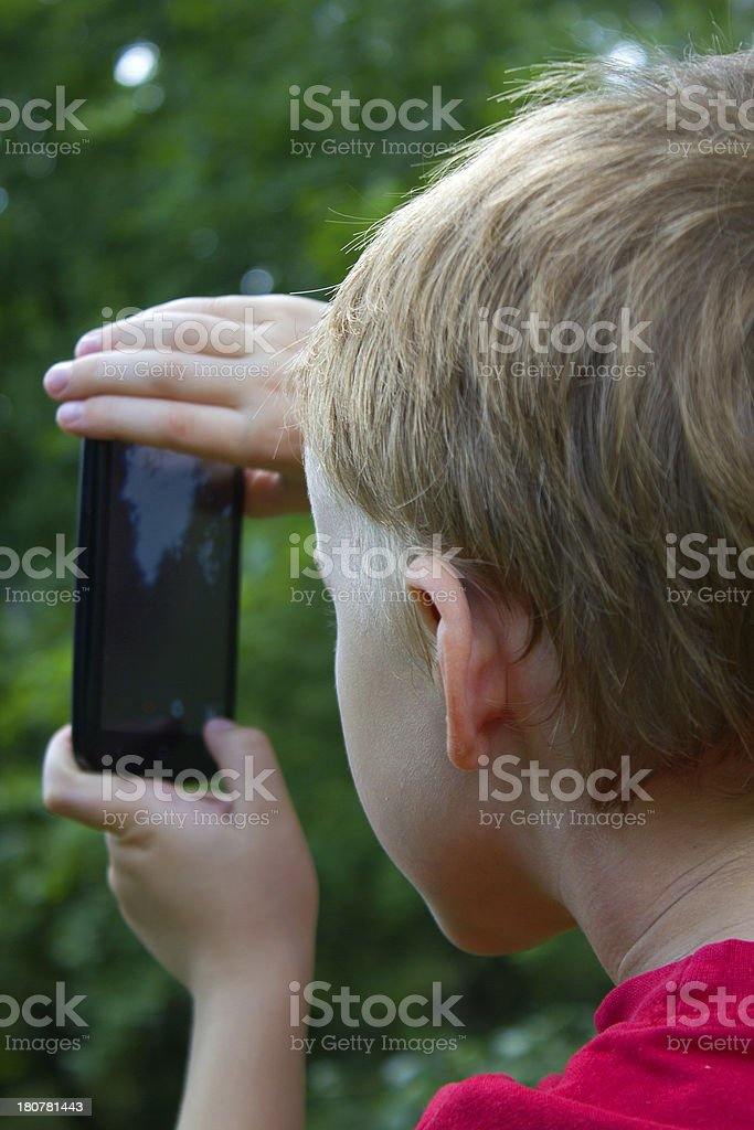 child and smartphone royalty-free stock photo