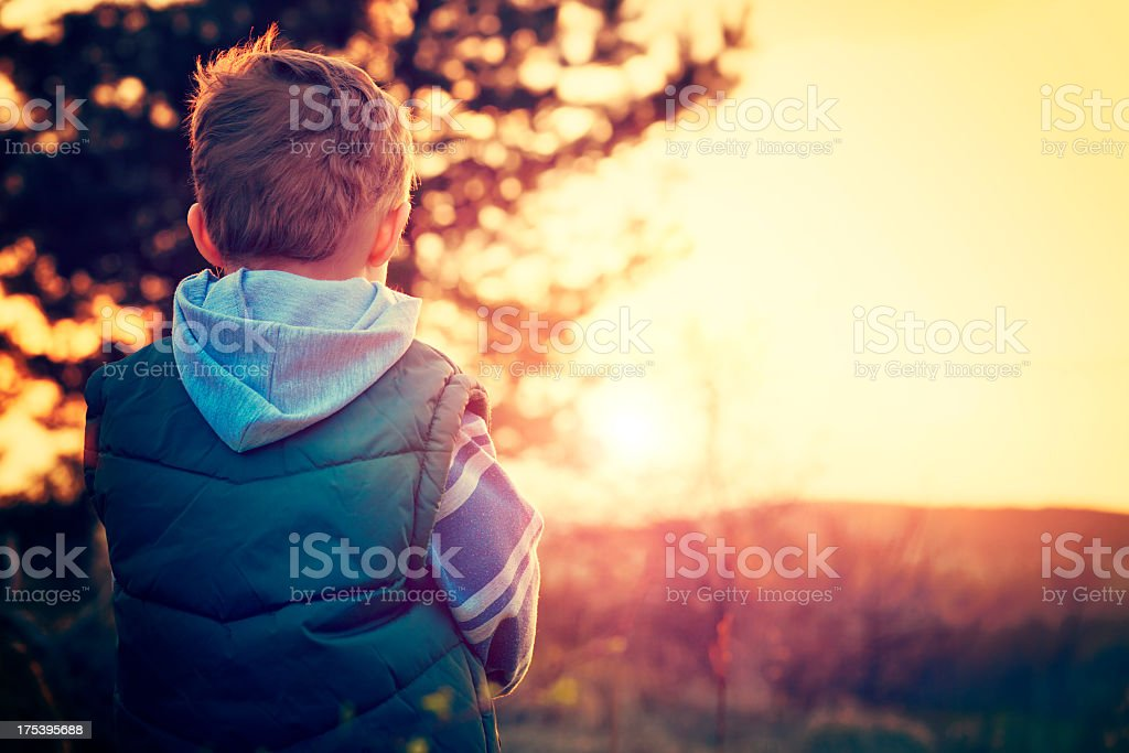 Child and sunset stock photo