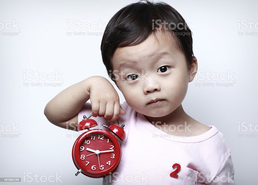 Child and the clock royalty-free stock photo
