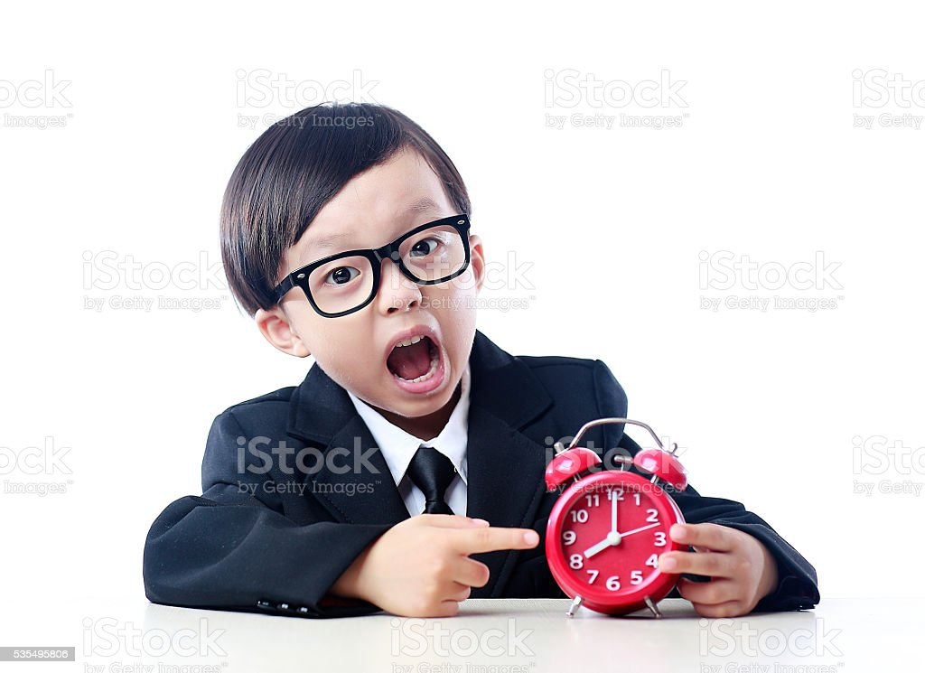 Child and the clock stock photo