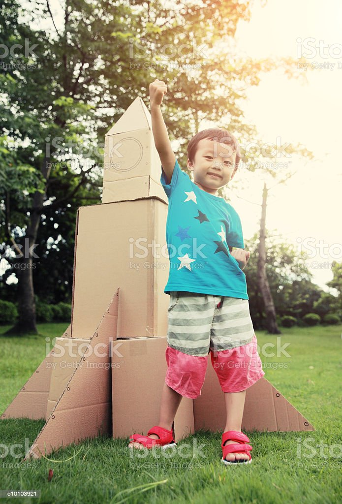Child and Toy Space Rocket stock photo