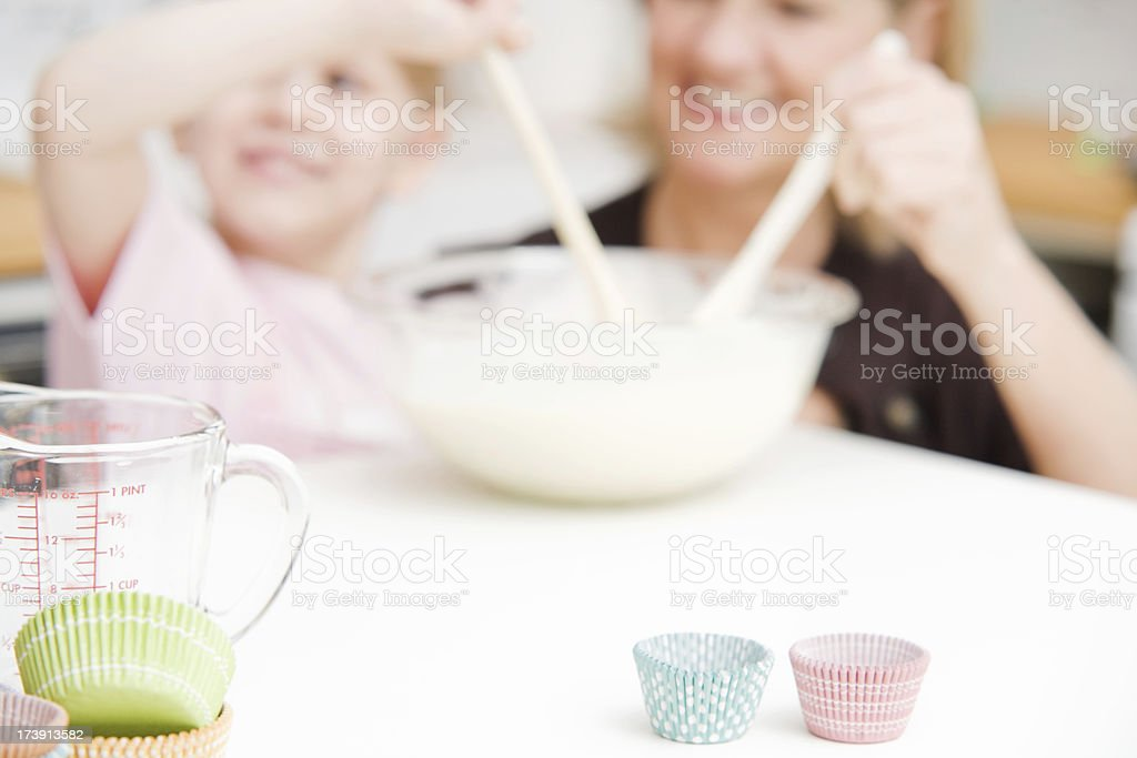 Child and Woman Baking Cupcakes Background royalty-free stock photo
