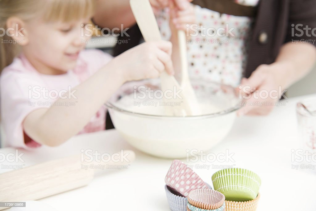 Child and Woman Baking Cupcakes royalty-free stock photo