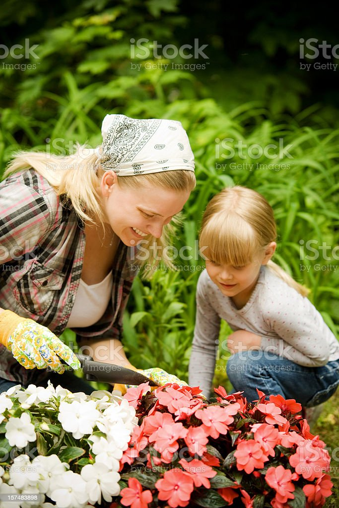 Child and Woman Gardening with Flowers Lifestyle royalty-free stock photo