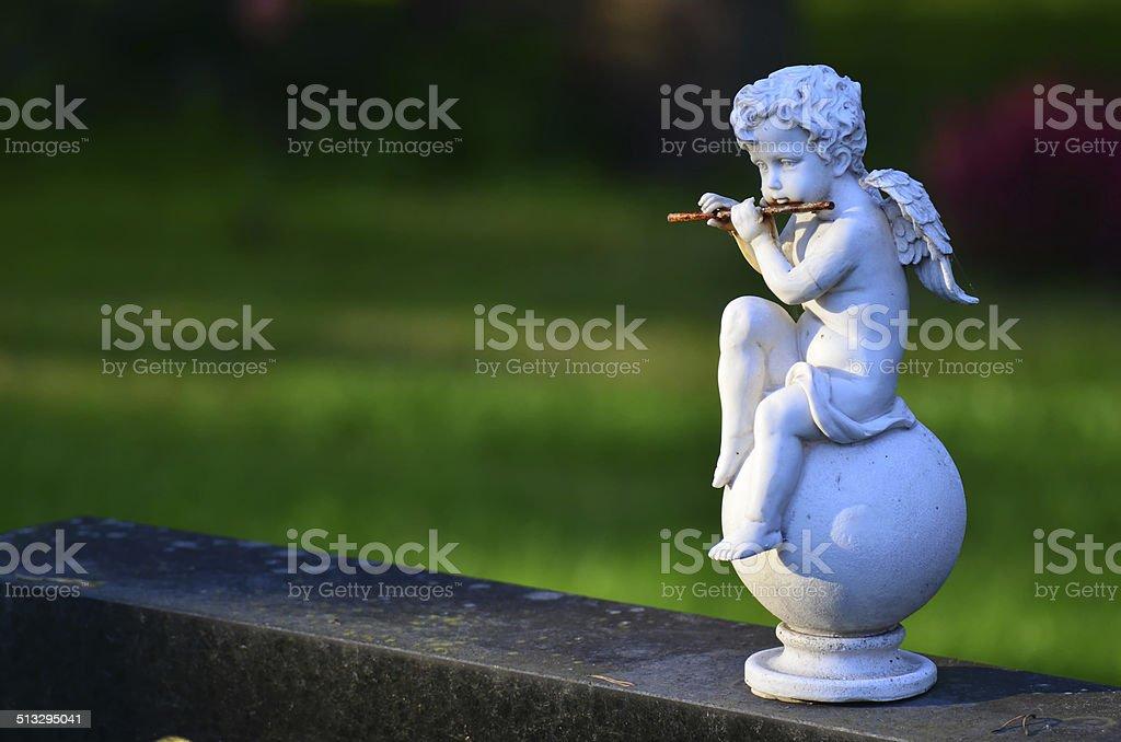 Child angel statue on cemetery stock photo