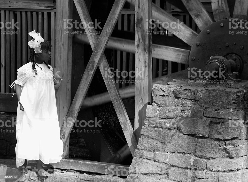 Child at an old mill royalty-free stock photo