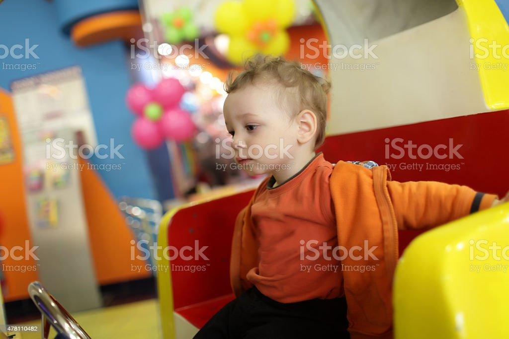 Child at indoor playground stock photo