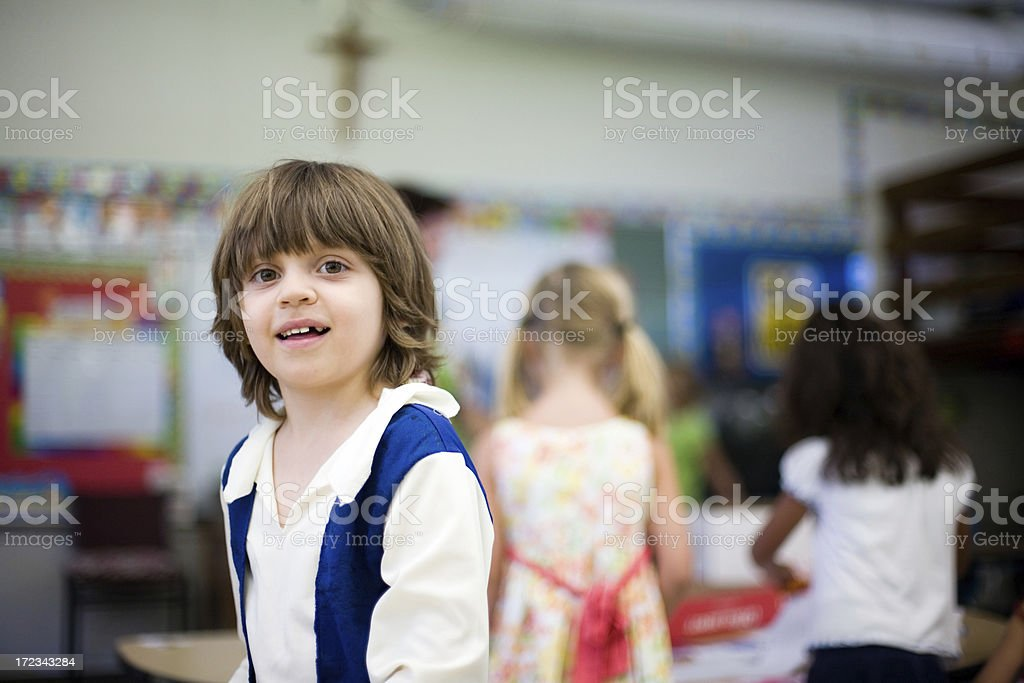 Child at kindergarten with friends to the background. royalty-free stock photo