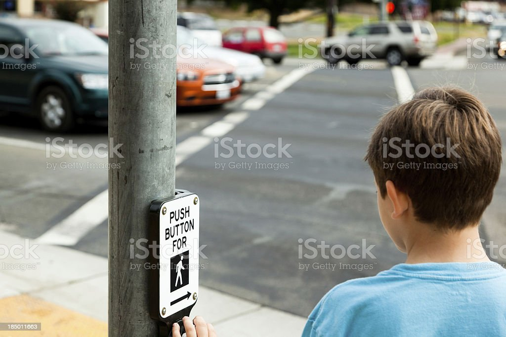 Child at Pedestrian Crossing stock photo