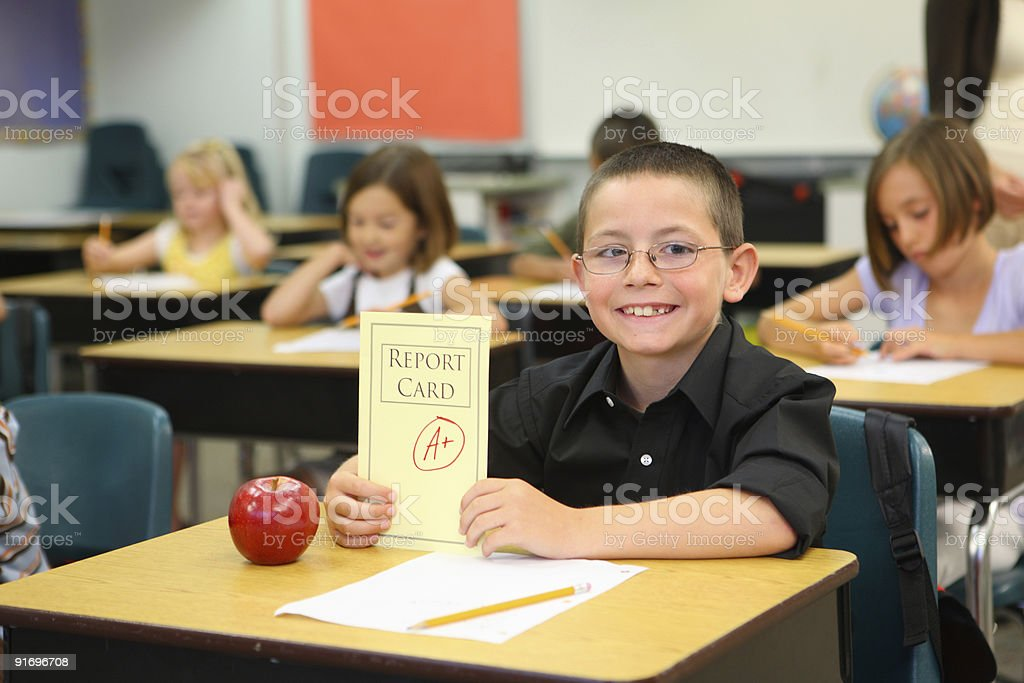 Child at school with report card stock photo
