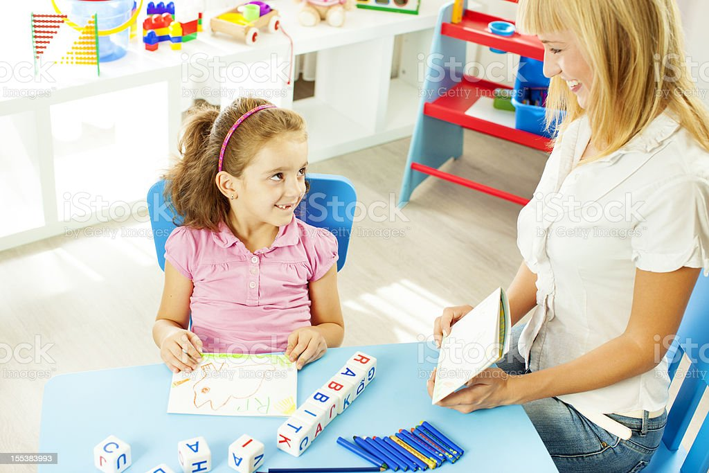 Child at speech therapy session. stock photo