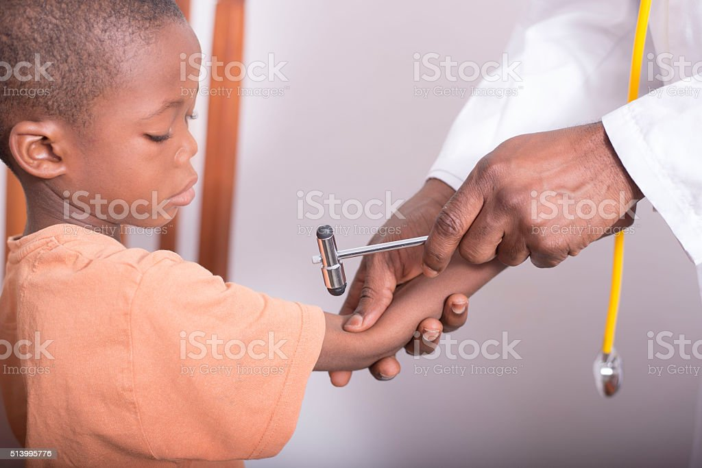 Child at the doctor stock photo