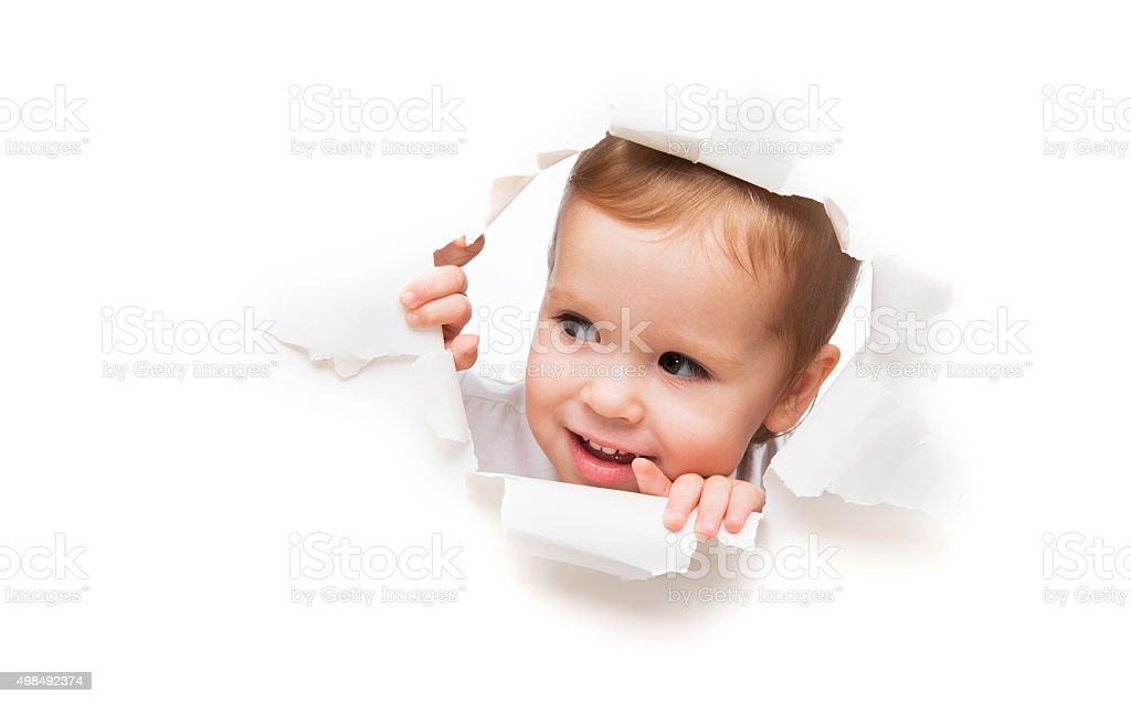 child baby girl peeping through hole in empty white  poster stock photo
