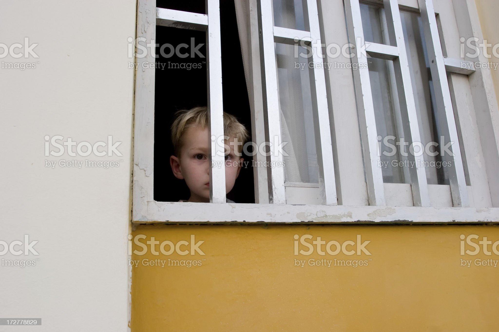 Child behind bars royalty-free stock photo