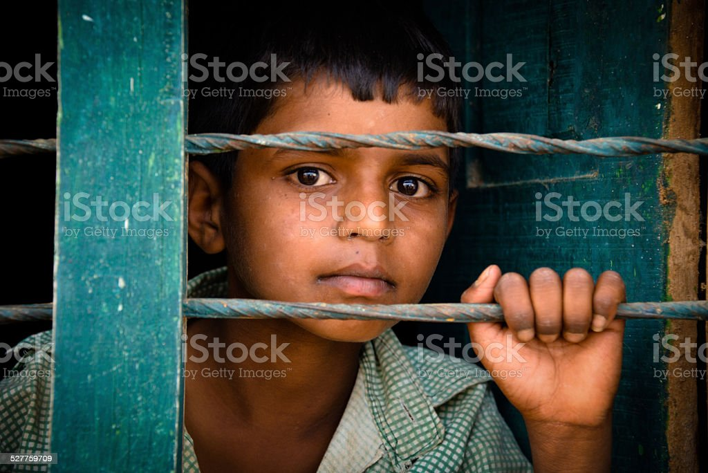 Child behind the bars stock photo