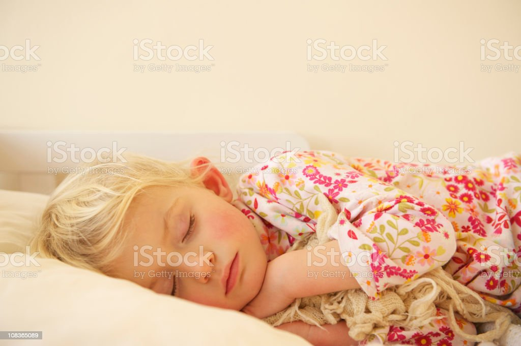 Child blissfully asleep stock photo