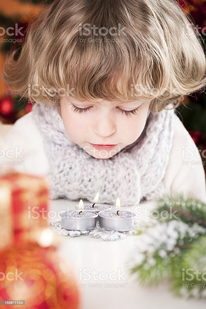 Child blowing out candles royalty-free stock photo