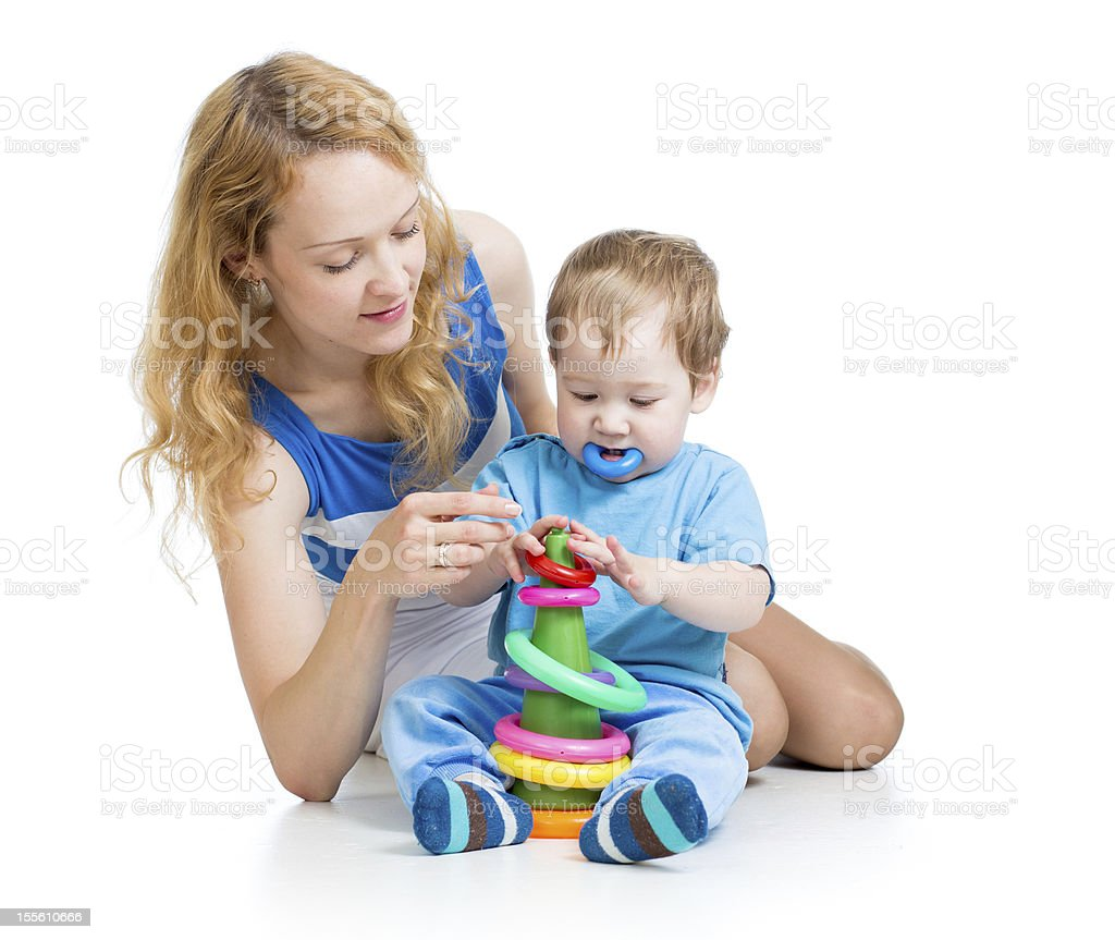 child boy and mother playing together with construction set toy royalty-free stock photo