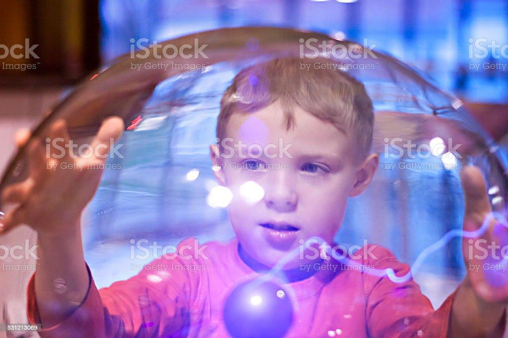 Child boy playing Tesla Ball stock photo