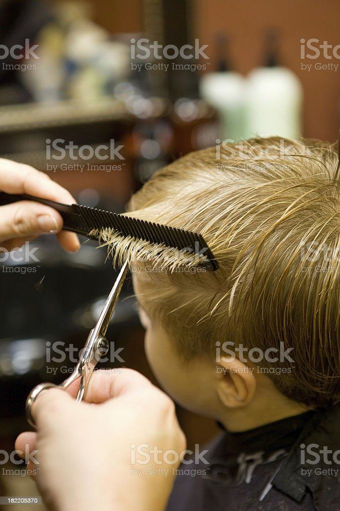 Child Boy Receiving a Hair Cut royalty-free stock photo