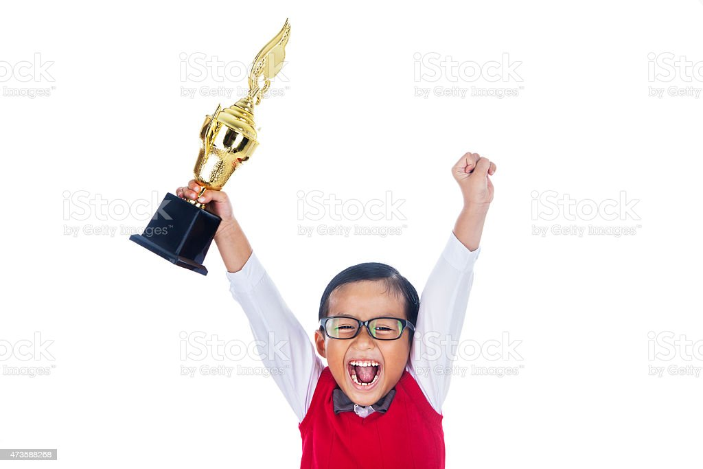 Child boy winning and celebrating with a trophy stock photo