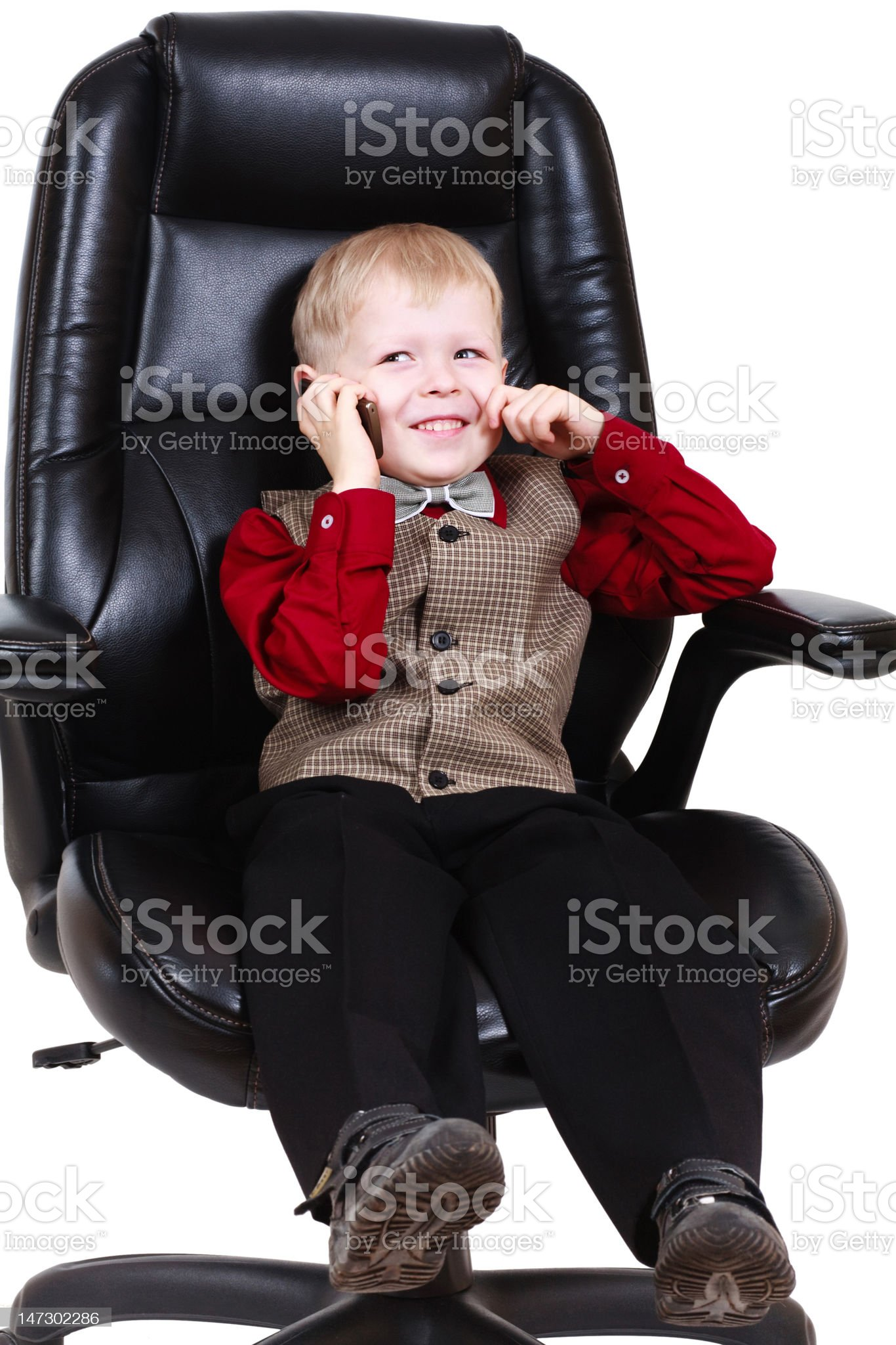 Child businessman boss calling by phone royalty-free stock photo