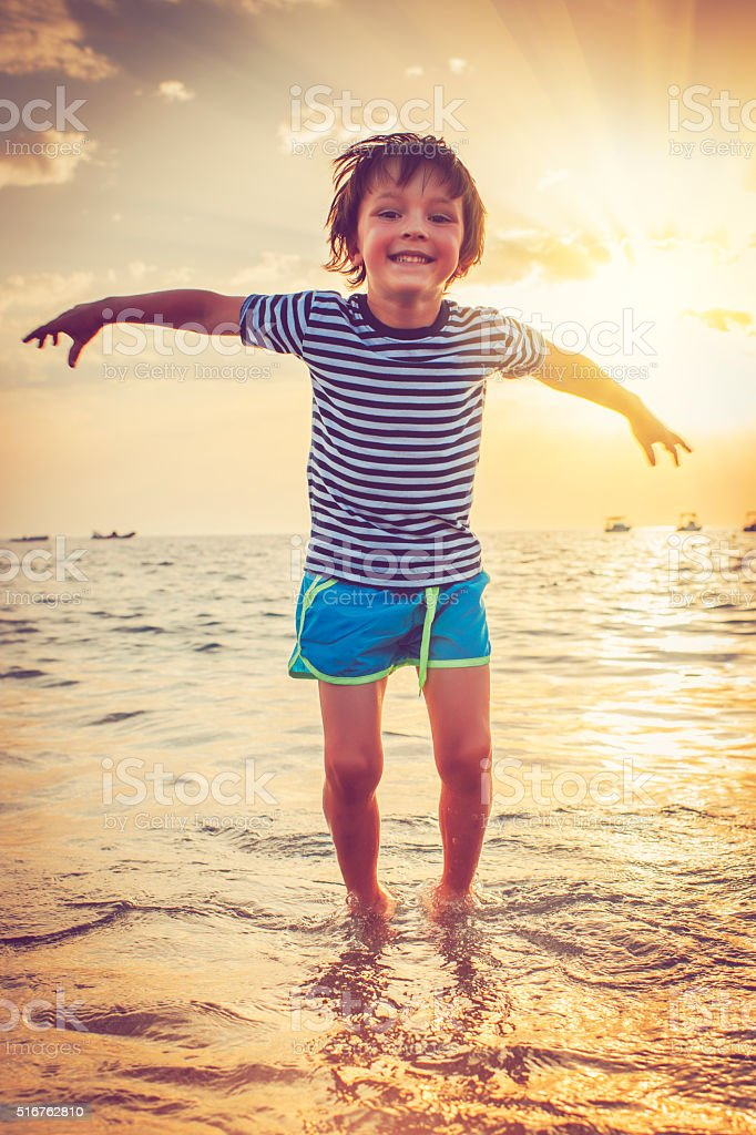 Child by the sea stock photo