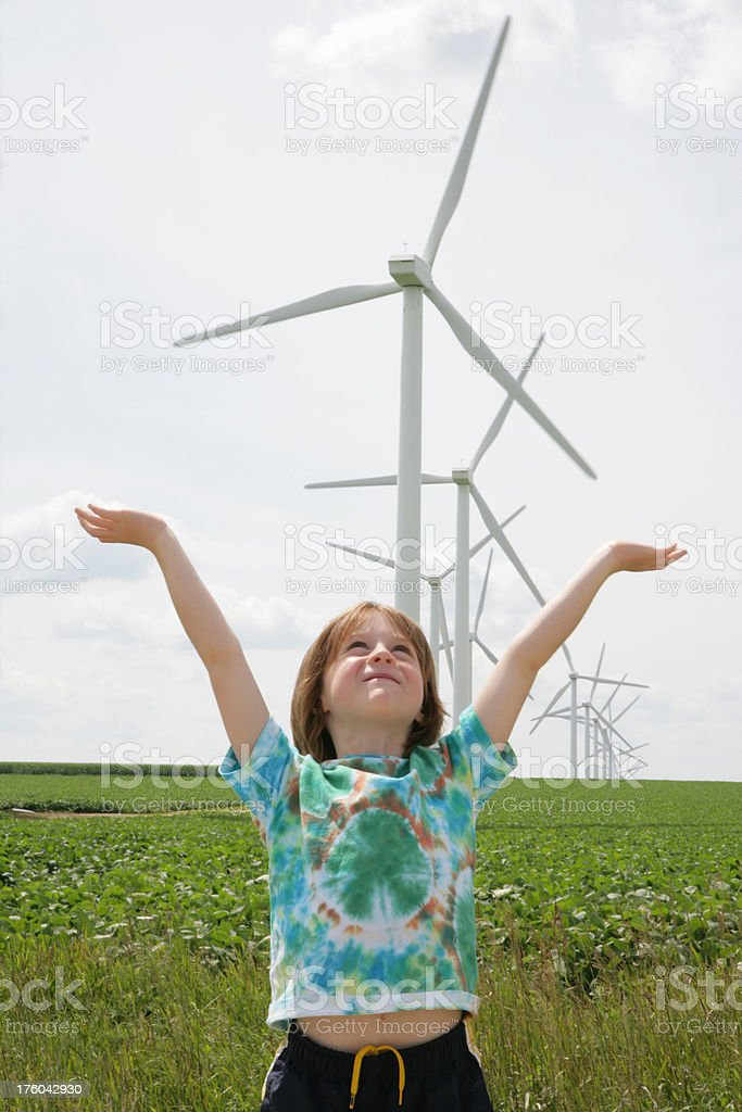 Child Celebrating with Raised Arms Renewable Energy-  Wind Turbines royalty-free stock photo
