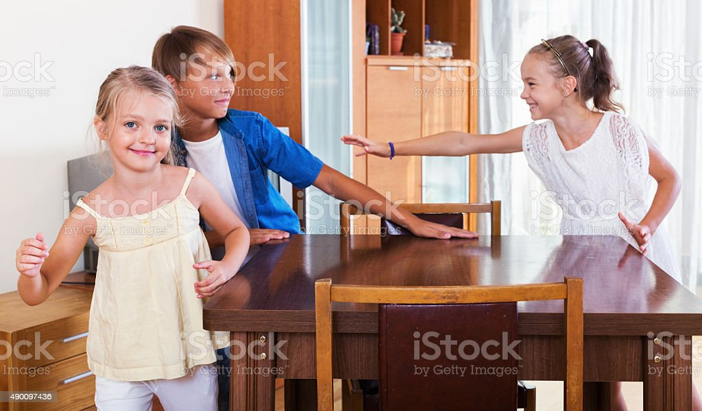 child chasing other kids to tag or touch them stock photo