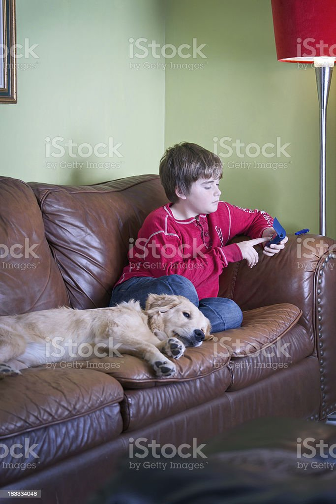 Child checking his blood sugar level stock photo