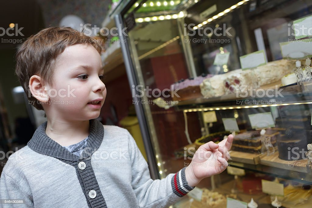 Child choosing a cake stock photo