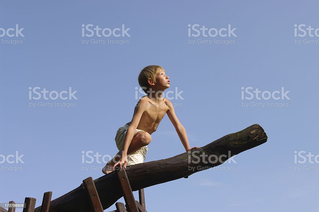 Child clambering on wooden play equipment royalty-free stock photo