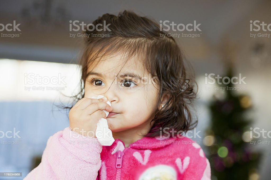 Child Cleaning her nose with Tissue royalty-free stock photo