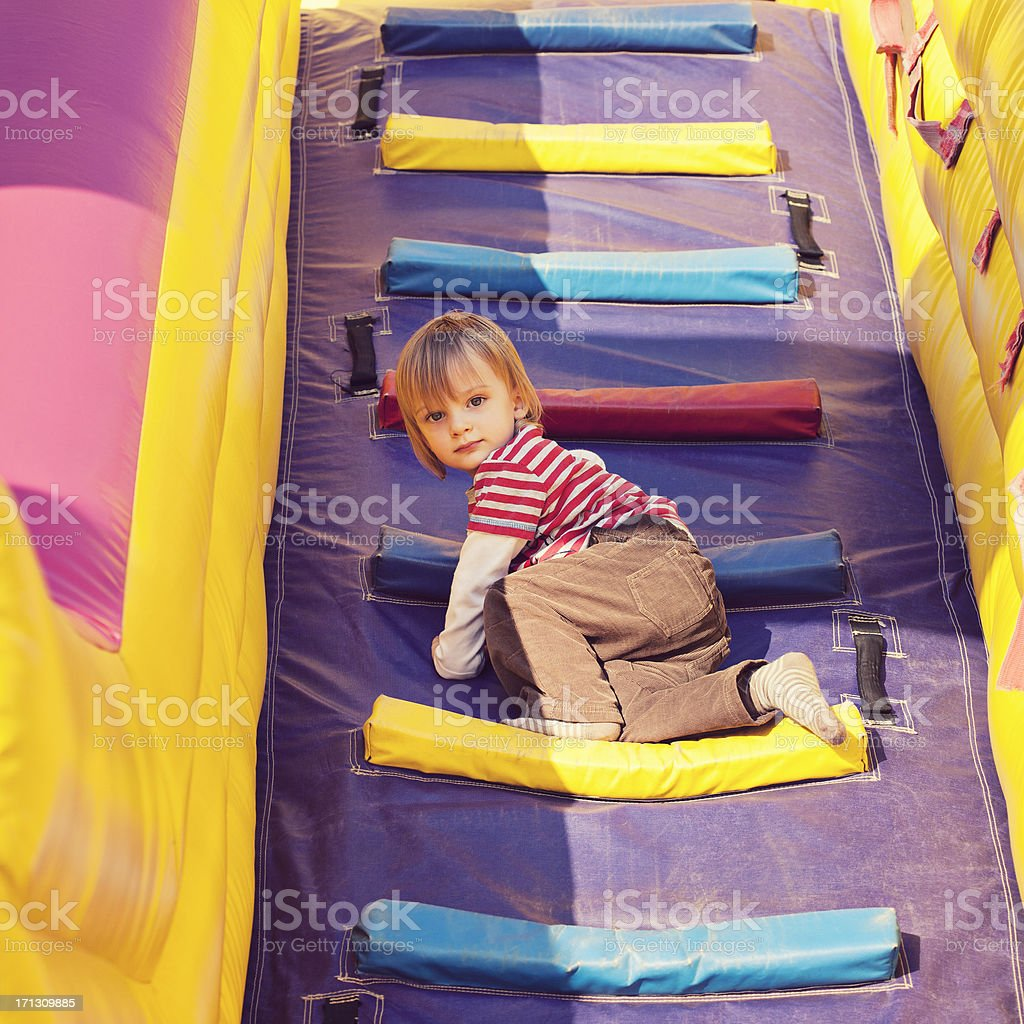 Child climbing on inflatable playground royalty-free stock photo
