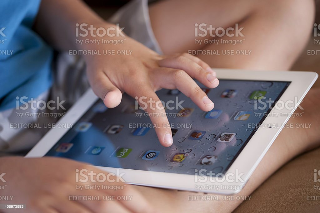 Child Close-up Using iPad2 royalty-free stock photo
