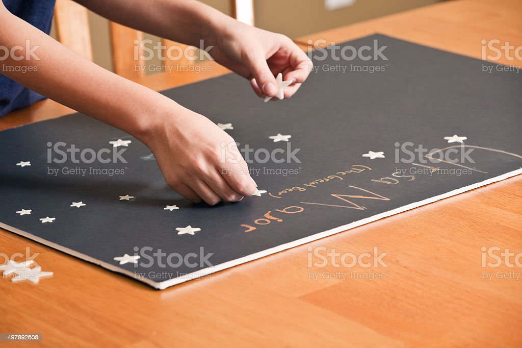 Child Constructing Ursa Major Constellation Science Project stock photo