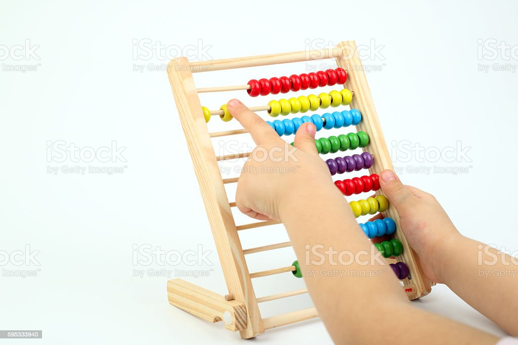 Child counting with an abacus stock photo